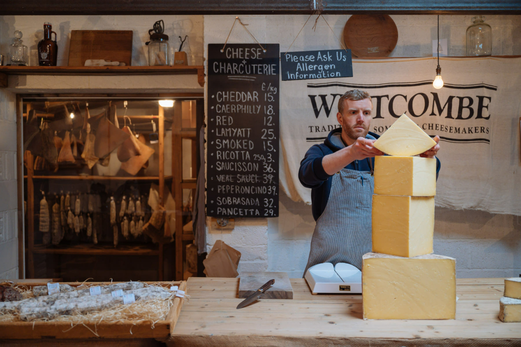 Paul Burton weighs up some cheddar at Westcombe Dairy